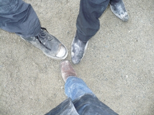 Lexa, Aleks, and Ian display their footwear.