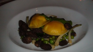 Ricotta and Egg Yolk Ravioli with fava beans, french breakfast radishes, and black truffles.