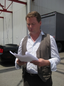 Patrick Gilmore (Volker) checks out the latest script.