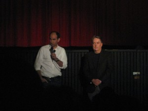 "Show Creators/Executive Producers Robert Cooper and Brad Wright give a speech before the screening.  ""The blue honda hatchback, license number 987 DFJ - you are parked in a fire lane.  You WILL be towed!"""
