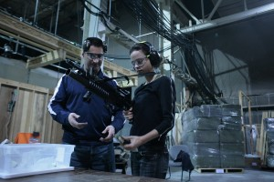 Actress Leela Savasta (Captain Alicia Vega) at gun school with armorer Rob Fournier.