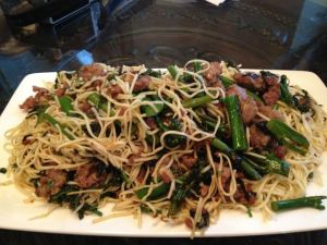 Spaghettini with Italian sausage, broccolini, garlic, basil, and olive oil.