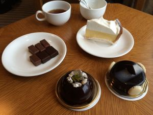 Clockwise from left to right: chocolates from Chocolat de H, cheesecake from Paul Basset, chocolate mousse cake from Sebastien Bouillet, and chocolate and pistachio mousse from Toshi Yoroizuka.