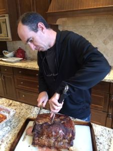 Rob mans the carving station.  On the menu: prime rib.