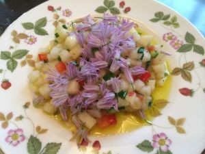 Summer salad with olive oil, ginger balsamic, and chive blossoms