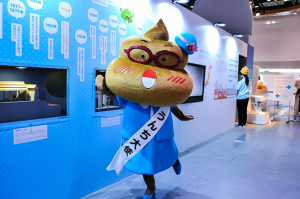 Who wants to hug Poopy, the exhibition mascot?