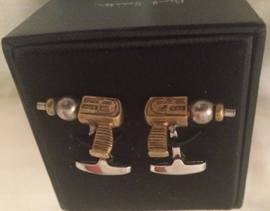 Comic books, purple dress shoes, and these ray run cufflinks.  I'm not on the hunt four some Flintstone cuffs.