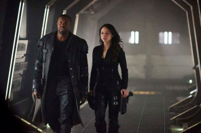 """DARK MATTER -- """"She's One of Them Now"""" Episode 207 -- Pictured: (l-r) Roger Cross as Six, Melissa O'Neil as Two -- (Photo by: Russ Martin/Prodigy Pictures/Syfy)"""